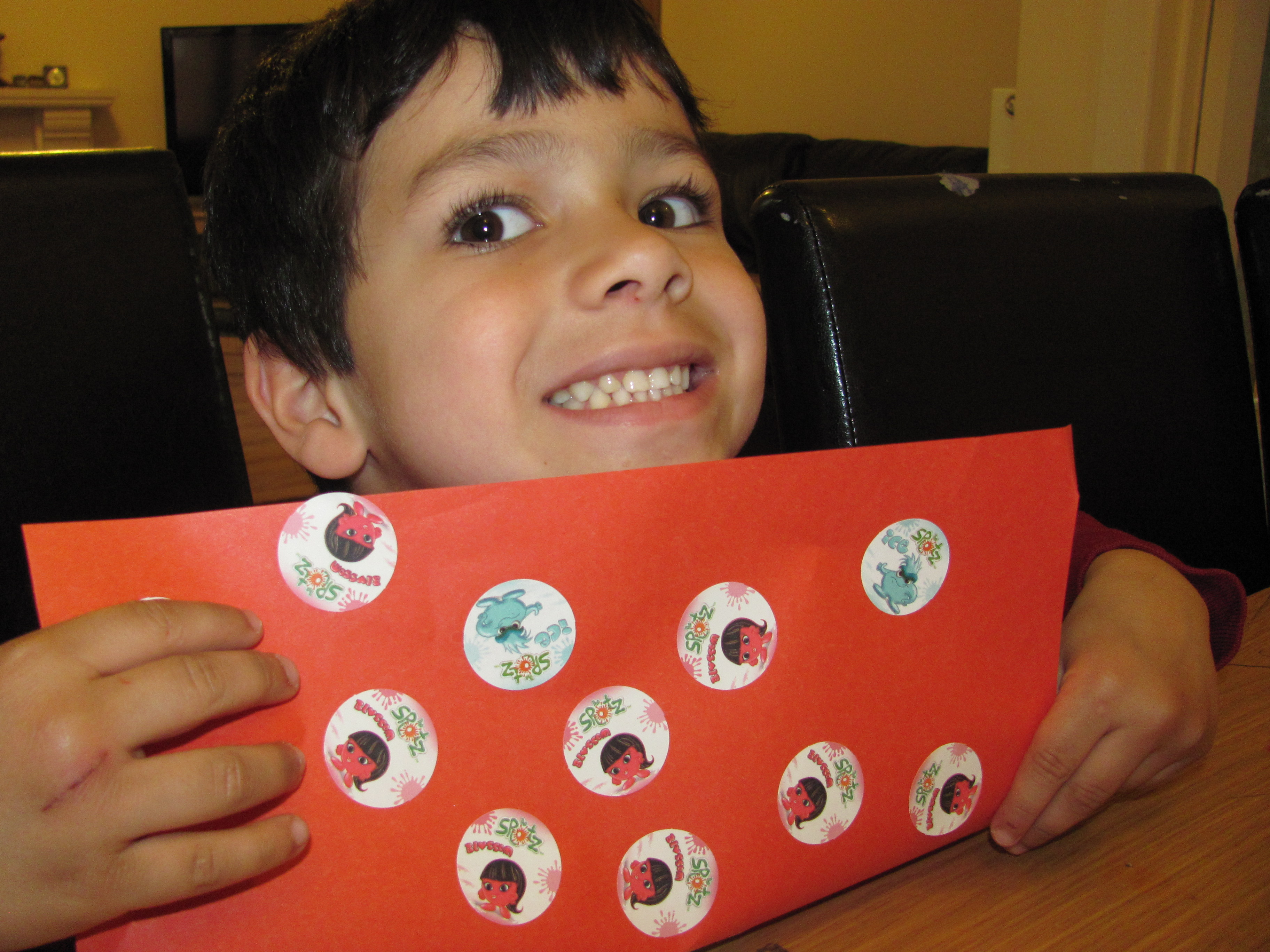 boy with a picture made from scented stickers