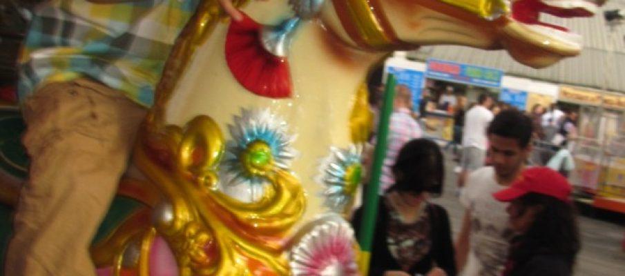 little boy on fairground horse merry-go-round merrygoround merry go round ride