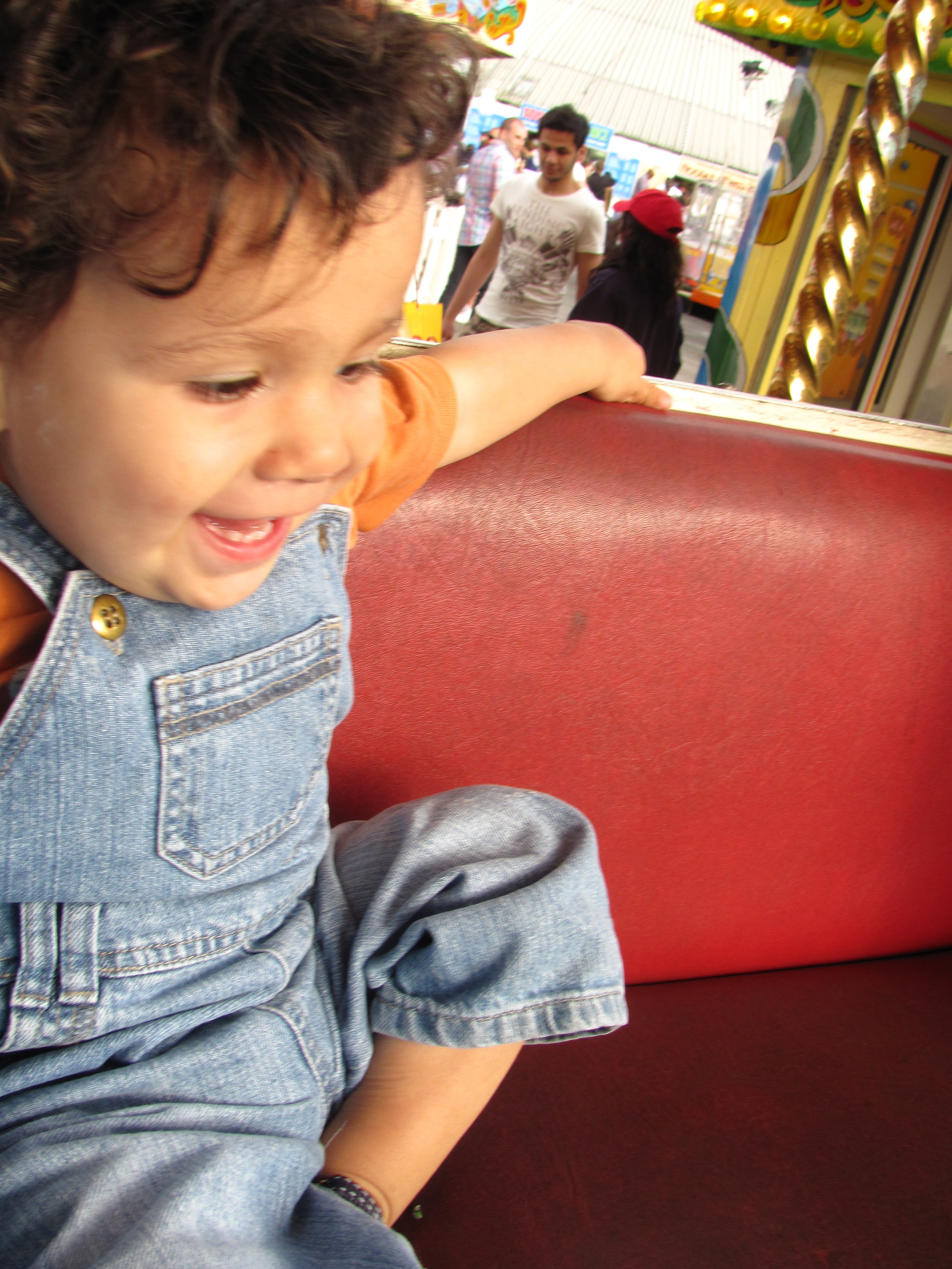 excited happy baby on a fairground ride