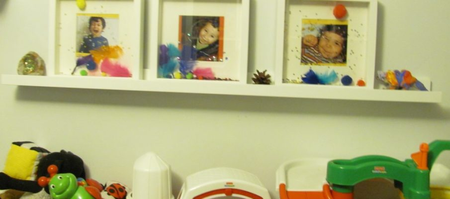 childrens playroom shelf with photos decorated