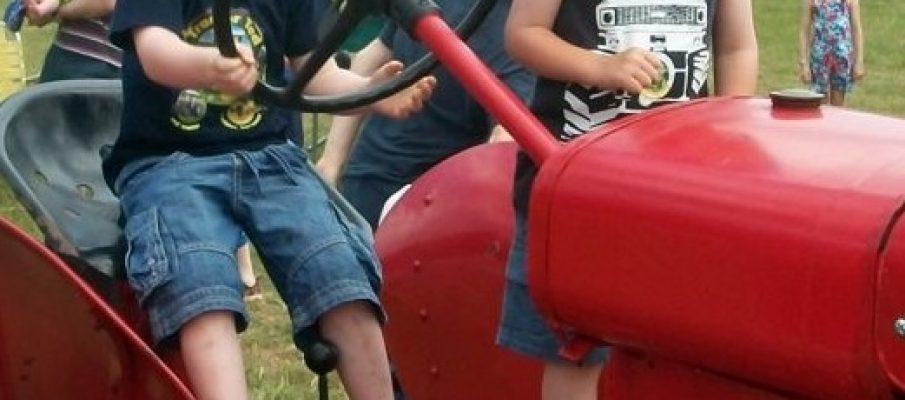 Boys on vintage tractor