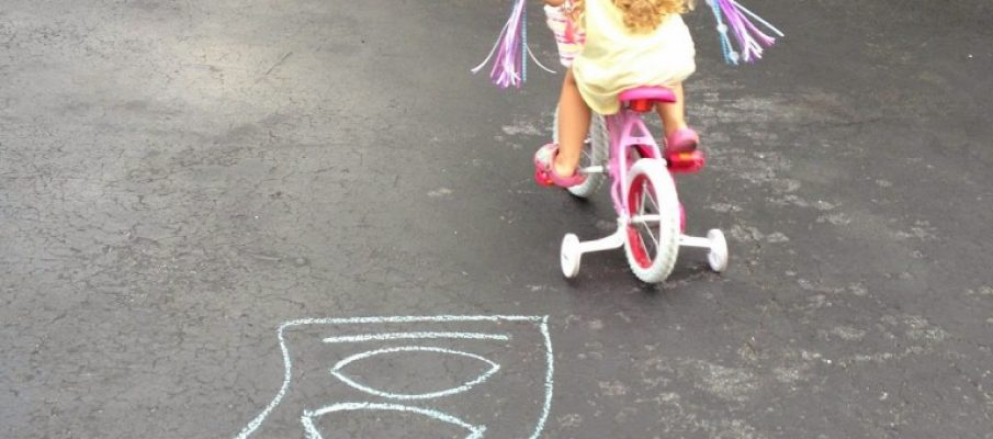 Tiffany pedaling bike and learning numbers good shot june 2014 pm