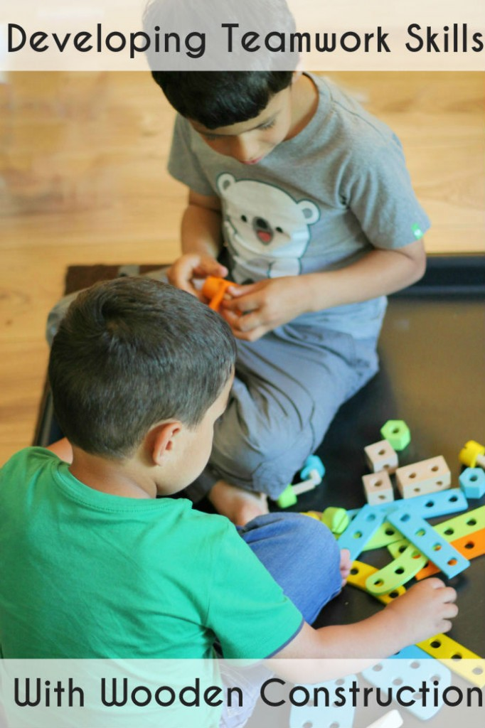 Developing teamwork skills with a wooden construction activity - great for siblings of different ages