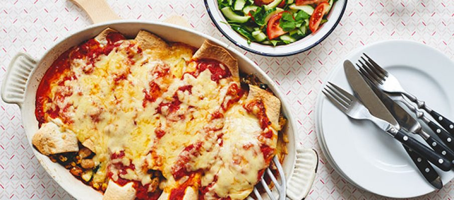 Cheesy veggie enchiladas with cucumber salad