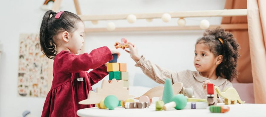 girl-in-red-dress-playing-a-wooden-blocks-3662667
