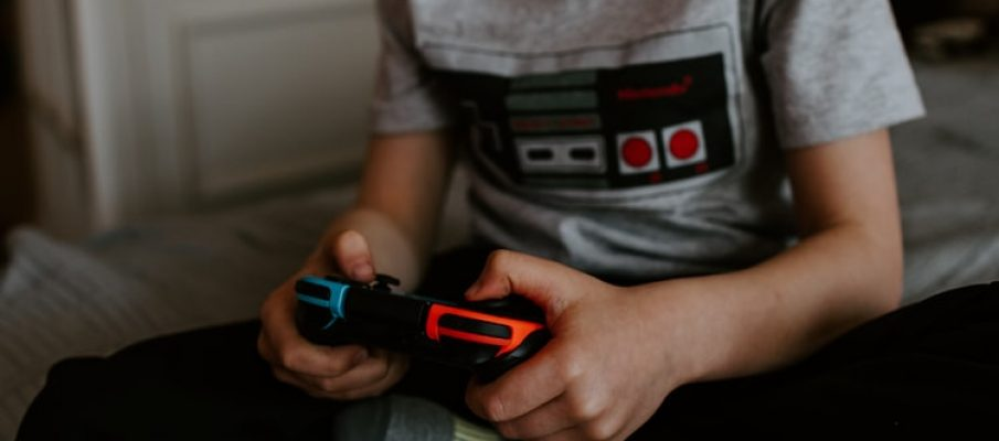Kid using a game controller